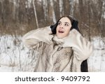surprised girl in a fur coat - stock photo