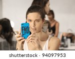 NEW YORK - SEPTEMBER 13: Model holds iPhone with Fashion Night Out case backstage during Spring/Summer 2012 during Mercedes-Benz Fashion Week on September 13, 2011 in New York. - stock photo
