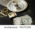 cash on table in exchange for gold and silver - stock photo