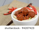 Xiu Mai - Vietnamese spicy pork meatballs in fragrant tomato sauce served with noodles.  - stock photo