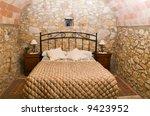 A Rustic Bedroom In A Rural...