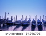 Gondolas in the morning fog, Venice - Italy. - stock photo