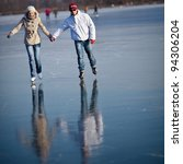 couple ice skating outdoors on... | Shutterstock . vector #94306204