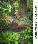 """Water Bearer in Garden"" A statue with fountain in Brookgreen Gardens near Myrtle beach in South Carolina. - stock photo"