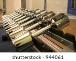 A rack of shining new weights in a gym - stock photo