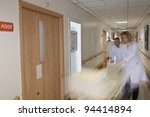 Blurred emergency hospital bed with medicals - stock photo