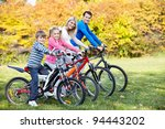family with children on bikes... | Shutterstock . vector #94443202