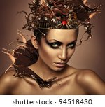 woman with chocolate in head and splash - stock photo