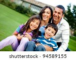 happy family outdoors with a... | Shutterstock . vector #94589155