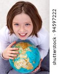 Young girl studying geography with an earth globe - stock photo