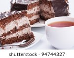 the chocolate cake and cup of tea - stock photo