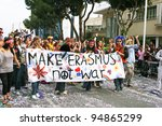 LIMASSOL, CYPRUS - MARCH 6, 2011: Unidentified participants  in hippie costumes during the carnival parade, established in 16th century, influenced by Venetians. - stock photo
