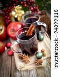 Hot spiced wine on wooden ground - stock photo