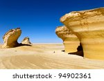 View of rocks and dunes in Sahara desert - stock photo