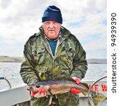 Senior  Fisherman On Boat  Dee...