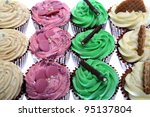 Fresh cupcakes isolated in the studio - stock photo