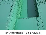 Abstract view of green painted steel beams and girders with many rivets - stock photo