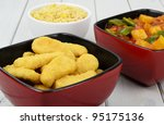 Sweet and Sour Chicken - Chinese fried chicken, sweet and sour sauce with bell peppers and pineapple with a side dish of egg fried rice. - stock photo