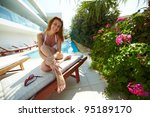 attractive woman sitting on a... | Shutterstock . vector #95189170