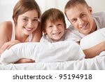 smiling family in the bedroom | Shutterstock . vector #95194918
