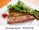 grilled beef steak with green salad and asparagus - stock photo