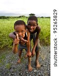 MANZINI, SWAZILAND-DEC 27: Portrait of unidentified Swazi boys on Dec 27, 2007 in a small village near Manzini, Swaziland.  Close to 10% of Swaziland's total population are orphans, due to HIV/AIDS. - stock photo