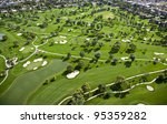 Aerial View Of Tree Lined Golf...