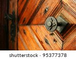 medieval door handle to lock in the background - stock photo