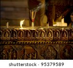 burning incense and candles in a temple / church - stock photo