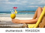Woman Holding A Fruit Cocktail...