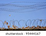 Barbed Wire On Prison Wall