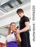 young couple exercising in gym... | Shutterstock . vector #95456320