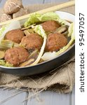 Lion's Head Meatballs - Chinese oversized pork meatballs stewed with napa cabbage. - stock photo