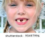 little blond girl with toothy grin - stock photo