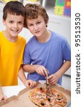 Hungry boys with pizza in their room - stock photo