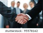 handshake in front of business... | Shutterstock . vector #95578162
