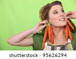 a female cook wearing carrots...   Shutterstock . vector #95626294