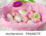 pink basket with easter eggs decoration - stock photo