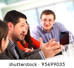 Businessman talking at a meeting - stock photo
