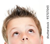 Extreme close up portrait of boy looking up.Isolated on white. - stock photo
