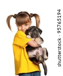 Stock photo portrait of little girl with cute puppy isolated on white background 95765194