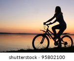 Silhouette Of A Cyclist At...