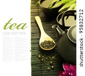 Asian tea set on bamboo mat (Green tea, orchid and chopsticks) with sample text - stock photo