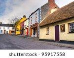 BUNRATTY, IRELAND - FEB 19: 19th century village street of Bunratty Folk Park, traditional Irish tourist attraction of Co. Clare - Feb 19, 2012 in Bunratty Folk Park, Co. Clare, Ireland. - stock photo