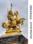 golden statue on Pont Alexandre Bridge, Paris, France - stock photo