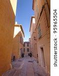narrow street in Saint Tropez, France - stock photo