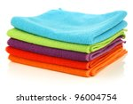 stacked colorful microfiber cleaning cloths on a white background - stock photo
