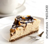 Caramel and chocolate cheesecake with a cup of coffee. - stock photo