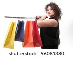 lovely woman with shopping bags and sword over white - stock photo
