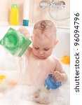 Little baby girl having soapy bath at home - stock photo